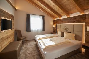 Ein Bett oder Betten in einem Zimmer der Unterkunft Rainerhof