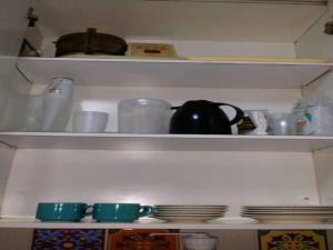 A kitchen or kitchenette at Apartamento Vista Mar no Jd.Armação