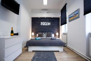 Krevet ili kreveti u jedinici u objektu Apartments Topcentar 2
