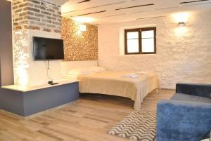 TV tai viihdekeskus majoituspaikassa Aasa Apartments