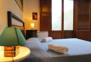 A bed or beds in a room at Lisola Residence