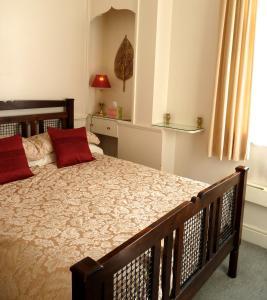 Cama o camas de una habitación en Crystal Palace Apartment