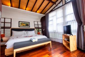 A bed or beds in a room at The Royal Bali Villas Canggu