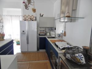 A kitchen or kitchenette at House in Punta Chiappa