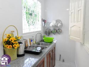 A kitchen or kitchenette at Gac Nho Homestay