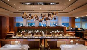 A restaurant or other place to eat at Apartment Residences at Park Hyatt Hamburg