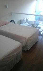 A bed or beds in a room at Bahia Flat