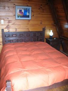 Una cama o camas en una habitación de Casita Alpina Aguca