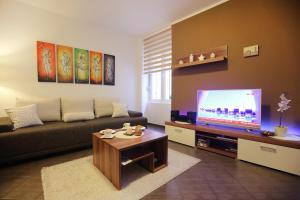 A television and/or entertainment centre at Allegro Exclusive Suites