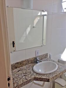 A bathroom at Guarujá Apartment