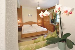 Ein Bett oder Betten in einem Zimmer der Unterkunft Apparthotel Thalerhof