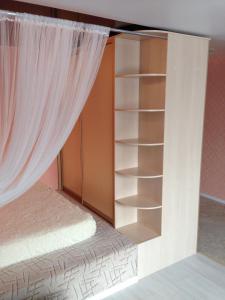 Кровать или кровати в номере Апартаменты на Выгонная 4