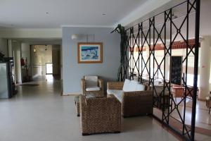 Ein Sitzbereich in der Unterkunft Apartamentos Magnolia Mar