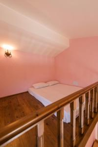 A bed or beds in a room at Ioanna Villa