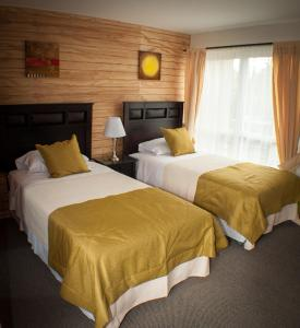 A bed or beds in a room at Madero Aysen ApartHotel