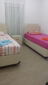 A bed or beds in a room at Felicia Residence