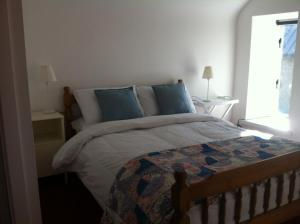 A bed or beds in a room at Camp Street B&B