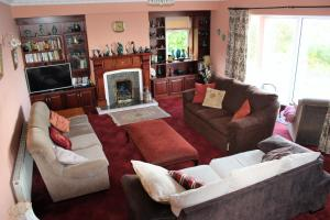 The lounge or bar area at Kilsallagh Cottage