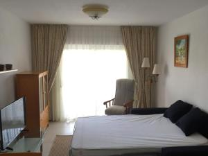 A bed or beds in a room at Fin Albir Playa