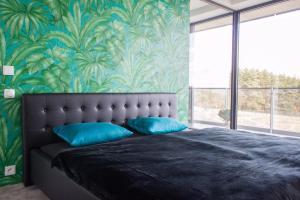 Postel nebo postele na pokoji v ubytování Amazing Apartments