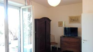 A television and/or entertainment center at Mita Buonarroti Penthouse Rooms with Terrace on Milan City Life