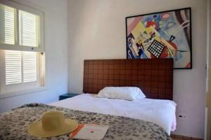 A bed or beds in a room at Casa Maravilhosa