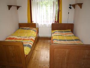 A bed or beds in a room at Farma Rybníček