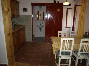A kitchen or kitchenette at Farma Rybníček