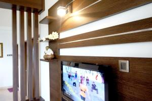A television and/or entertainment centre at Cameron View Apartment @ Crown Imperial Court Brinchang