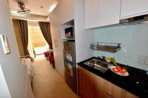 A kitchen or kitchenette at Saigon South Serviced Apartments