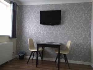 A television and/or entertainment center at King William Apartment
