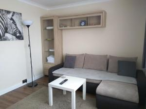 A seating area at King William Apartment