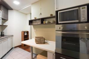 A kitchen or kitchenette at Apartments Zagreb Point - Vinogradska