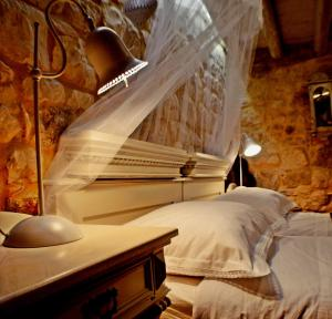 Krevet ili kreveti u jedinici u objektu Villa Residence Burgus-Antium