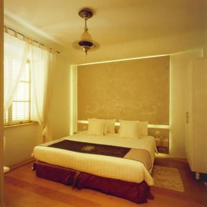 Postel nebo postele na pokoji v ubytování Lesic Dimitri Palace