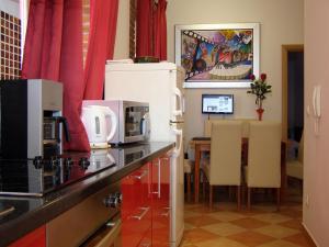 A kitchen or kitchenette at Split Artistic Apartments