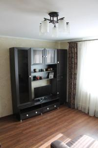 A television and/or entertainment center at U Megapolisa Apartment