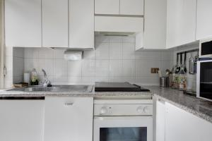 A kitchen or kitchenette at Lotto Apartment