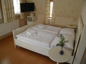 Ein Bett oder Betten in einem Zimmer der Unterkunft Ferienhaus Wiethüchter