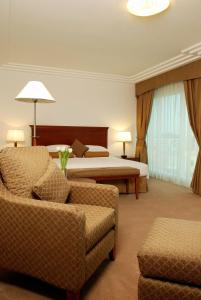 A bed or beds in a room at Grand Hyatt Residence