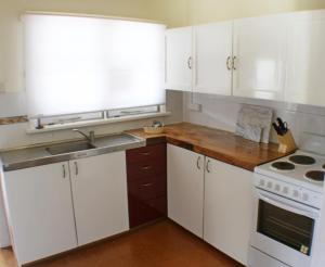 A kitchen or kitchenette at West End Retreat