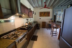 A kitchen or kitchenette at d'Amour Villa Bali