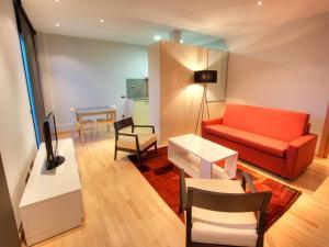 Ein Sitzbereich in der Unterkunft Tamarit Apartments