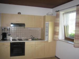 Una cocina o zona de cocina en Funerhof