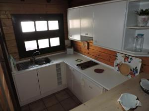 A kitchen or kitchenette at Apartamentos Santa Ana - Adults Only