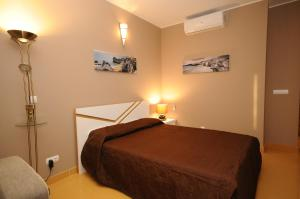 A bed or beds in a room at Algarve Flat