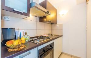 A kitchen or kitchenette at Apartment Ivan Mili
