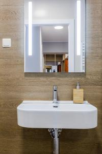 A bathroom at Warm Street Apartment - Peace and Comfort