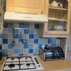 A kitchen or kitchenette at Harman Suites Self-Catering Apartments