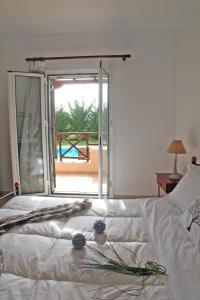 Ένα ή περισσότερα κρεβάτια σε δωμάτιο στο Echinades Resort